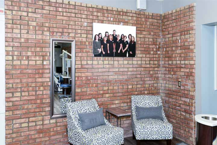 our staff photo on warm brick wall