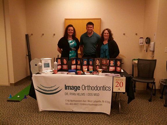Cassie, Dr. Helms and Marina representing Image Orthodontics at 2013 IU Health & Safety Fair